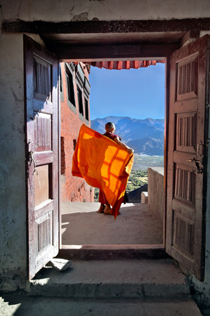 Monk adjusts his upper robe
