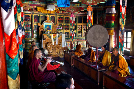 Monks performing puja